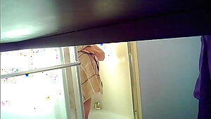 Son sets up spycam in shower to see mom