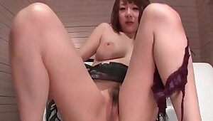 Bubble butt darling Arisa Asaki is toyed to orgasm